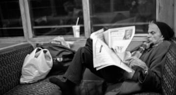 Man-Reading-Newspaper-Bakerloo-Line-Train